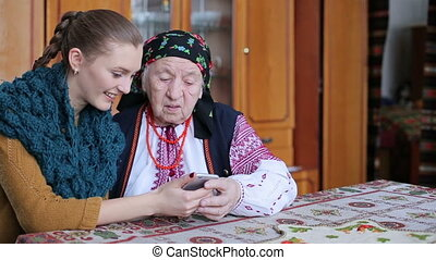 grandmother looking at mobile phone HD