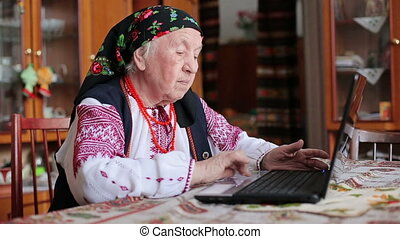 grandmother working with laptop