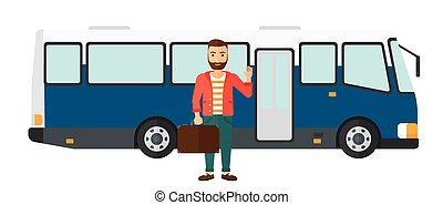Man standing near bus - A man standing at the entrance door...