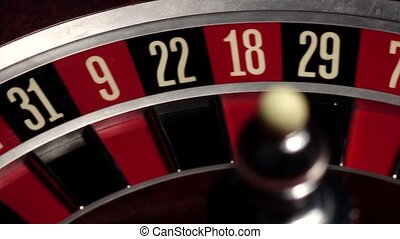 Roulette spins quickly, ball, white, close up