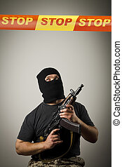 Man with gun and STOP line - Man in mask with gun and STOP...