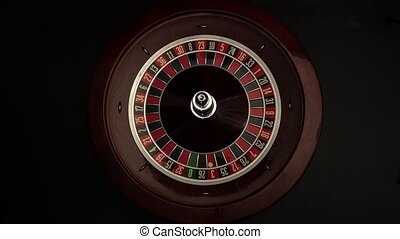 Roulette wheel is spinning slowly then stops black - The...