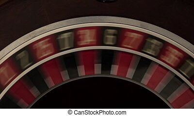 Classic roulette spinning fast black background white number...