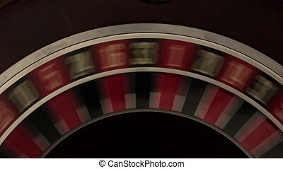 Classic roulette spinning fast black background - Classic...