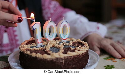 Ignition of candles on the cake. 100 anniversary HD