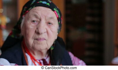 Very old woman alone in a scarf HD