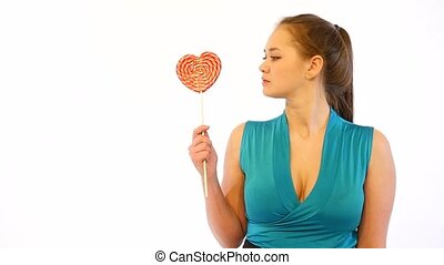 Girl Licking Heart Shaped Candy - Young Sexy Woman Licking...