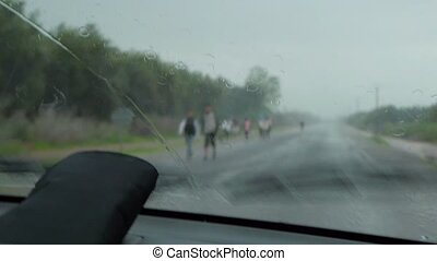 Car wipers are removing rain at car