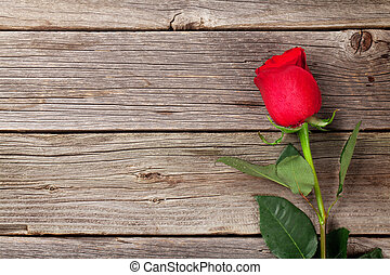 Red rose over wood