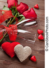 Red roses, hearts and champagne glasses over wood Valentines...