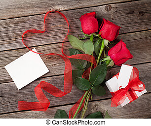 Red roses with Valentines day greeting card and gift