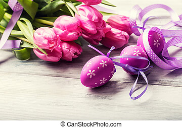 Happy easter Multicolored spring tulips and Easter eggs...
