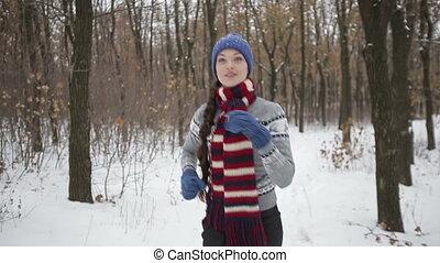 Sportswoman Runs in winter park