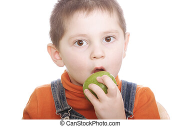 Surprized boy with green apple - Surprized little boy with...