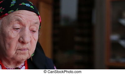 A view of an old woman in a headscarf HD