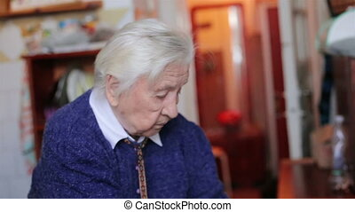 The old grandmother in the kitchen