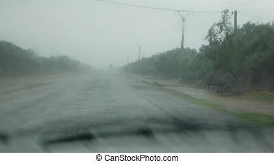 pov car driving in heavy rain