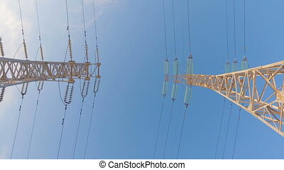 High-voltage tower with high voltage wires on a background...