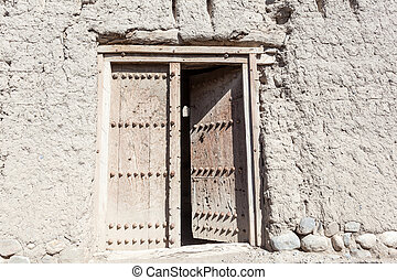 Door in a ruin of an old Omani village - Door at the ruin of...
