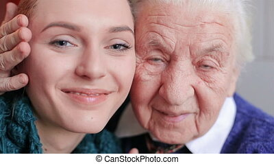 Happy grandmother and granddaughter look at the camera HD