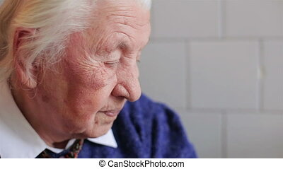 The sad sight of an old woman HD