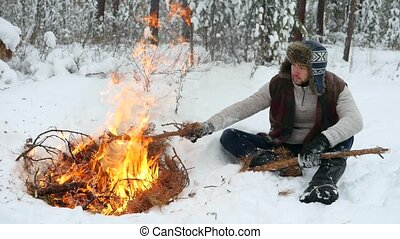 Man Set on Winter Campfire in the Forrest