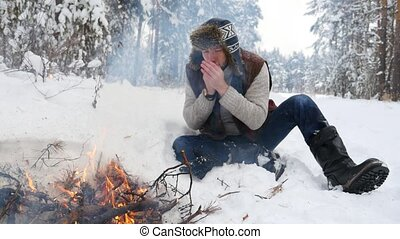 Man Warm Hands by Winter Fire in the Forrest