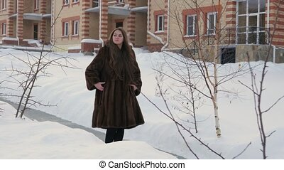 Girl Moving Through Winter Village in Fur-coat 4K