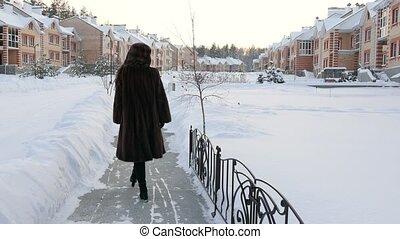 Girl in Fur-coat from Back Walking in Winter Village 4K