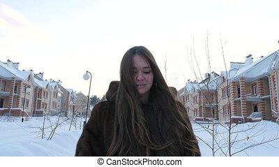Girl Walking in Fur-coat in Winter Village 4K