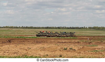 Russian tank at the landfill. Military exercises.