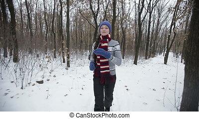 Sportswoman Runs in winter park - woman running in winter...