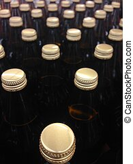 bottles golden caps assorted in lines - Brown ice beer...