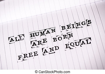 human rights text on paper - all human beings are born free...