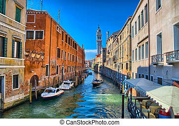 Scenic canal with Carabinieri boats, Venice, Italy, HDR