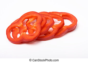 Sliced Red Peppers arranged on white background
