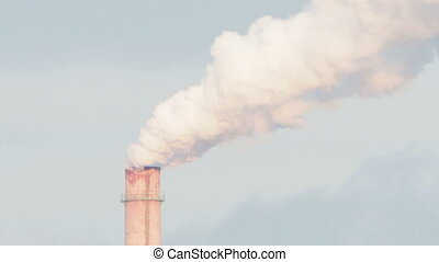 Smoke from Pipes of the Industrial Plant in the City -...