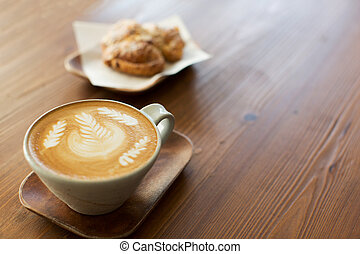 latte art in cafe - cup of latte coffee drink decorated with...