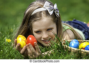 Child look for easter egg outdoor - Happy little girl look...