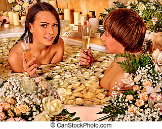 Couple relaxing at spa with flowers.