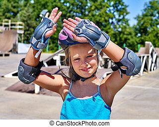 Girl riding on roller skates - Girl wearing helmet riding on...