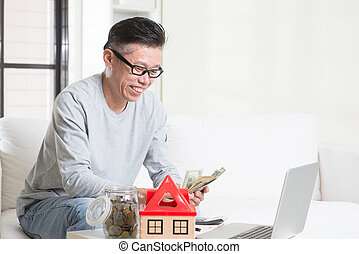 Mature Asian man counting on money - Portrait of 50s mature...