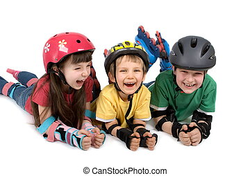 Kids in Safety Gear - Three happy children ready for inline...