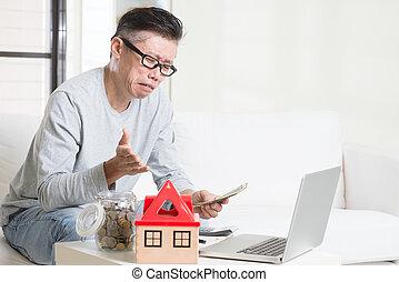 Cash flow problem concept Portrait of 50s mature Asian man...