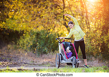 Young mother running - Beautiful young mother with her...