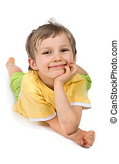 Smiling Boy - Portrait of a smiling young boy, laying on his...