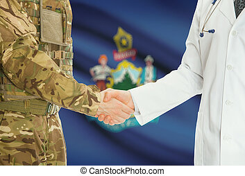 Military man in uniform and doctor shaking hands with US states flags on background - Maine