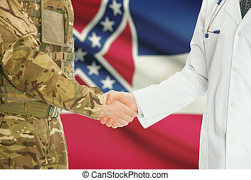 Military man in uniform and doctor shaking hands with US states flags on background - Mississippi
