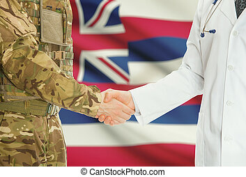 Military man in uniform and doctor shaking hands with US states flags on background - Hawaii
