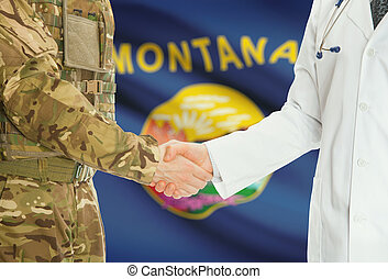 Military man in uniform and doctor shaking hands with US states flags on background - Montana